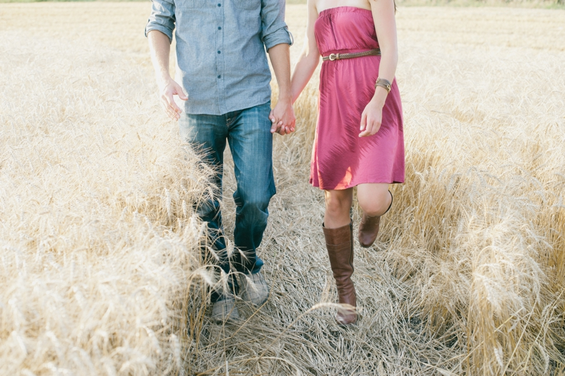 Couple in Manitoba wheat field
